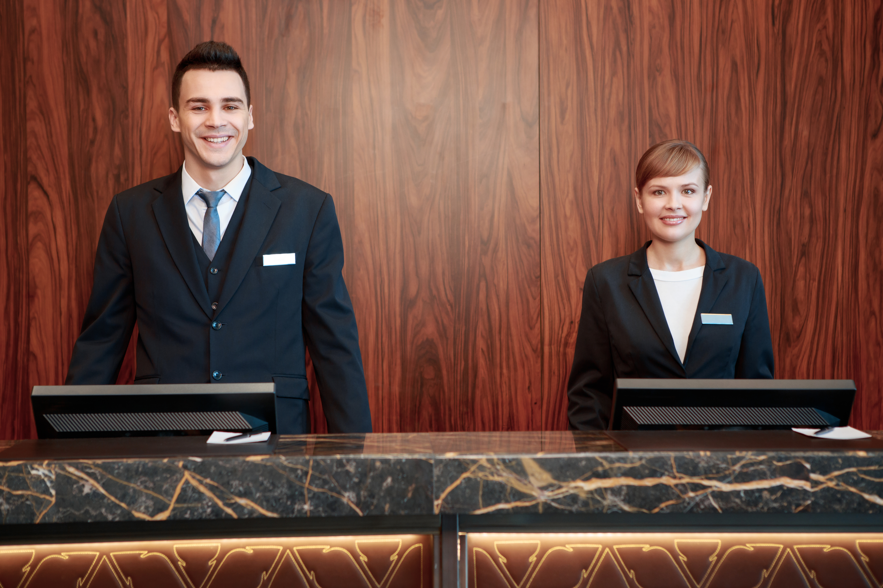hotel front desk man and woman